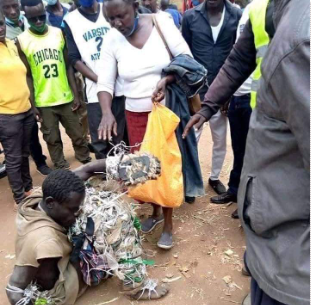 Magret Atieno rescuing with son