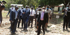 CS George Magoha while in Kisumu County. The bodyguard accused of sexually harassing a journalist is in a purple shirt.