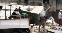 Residents salvage their properties from demolished houses in Buxton Estate, Mombasa County on March 5, 2021.