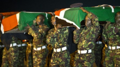 KDF Soldiers carry the remains of their fallen colleagues killed during an attack in El Adde, Somalia on January 15, 2016. |Photo| Courtesy|