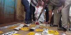 Police Collect Car Number Plates after Arresting Car Thieves