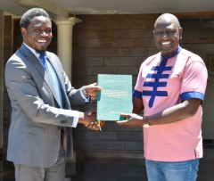 Deputy President William Ruto receives a copy of the memorandum sent to parliament in defence of the Constitution from LSK President Nelson Havi on August 27, 2021. |Courtesy| Twitter|
