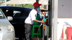 File image of an attendant at a fuel station.
